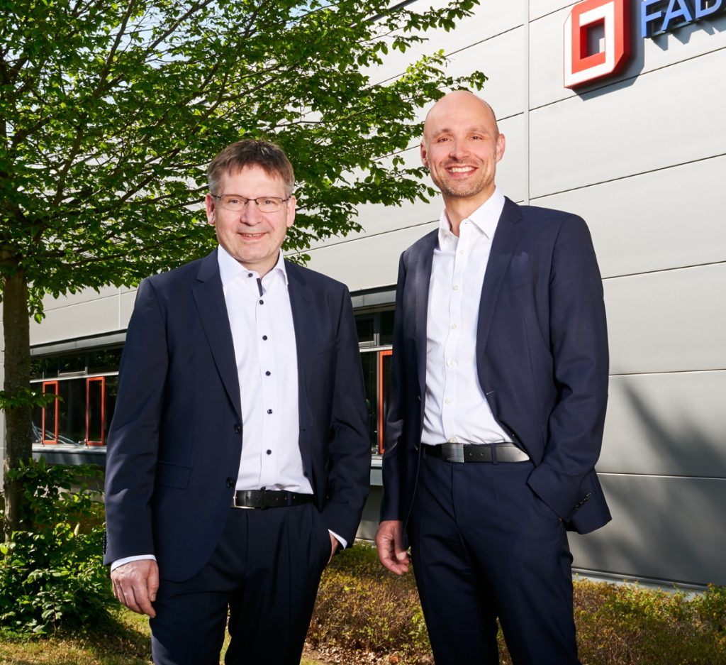 Fabmatics managing directors Dr. Roland Giesen and Dr. Andreas Purath in front of the Headquarters in Dresden, Germany
